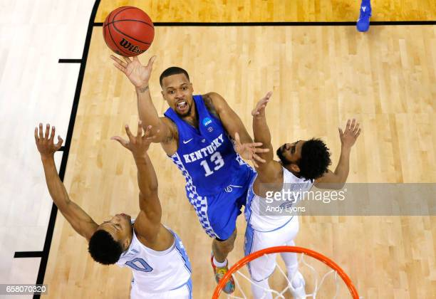 Isaiah Briscoe of the Kentucky Wildcats shoots against Nate Britt and Joel Berry II of the North Carolina Tar Heels in the first half during the 2017...
