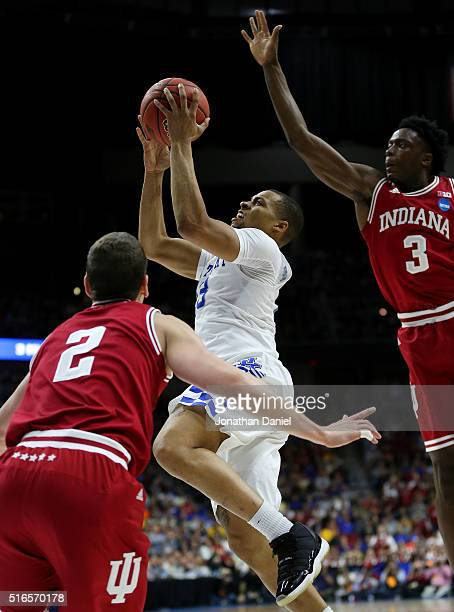 Isaiah Briscoe of the Kentucky Wildcats shoots against Nick Zeisloft and OG Anunoby of the Indiana Hoosiers in the second half during the second...