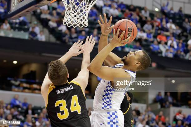 Isaiah Briscoe of the Kentucky Wildcats shoots the ball against Drew McDonald of the Northern Kentucky Norse in the second half during the first...