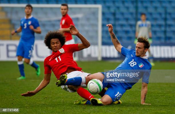 Isaiah Brown of England competes for the ball with Valerio Trani of Italy during the UEFA U17 Championship Qualifier Elite Round match between Italy...