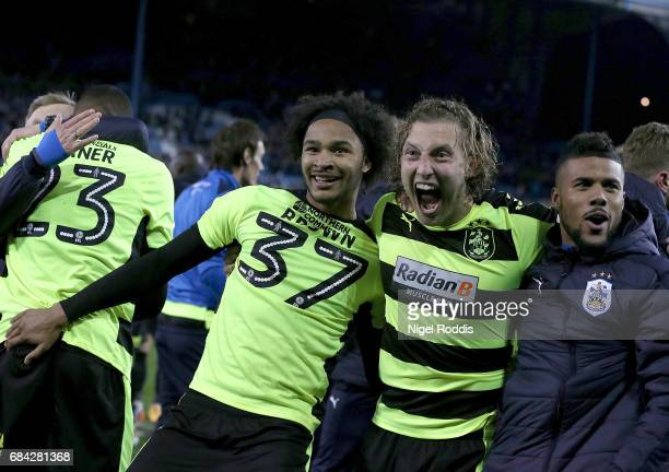 Isaiah Brown of Huddersfield Town and Michael Hefele of Huddersfield Town celebrate after their team go through to the final after winning a penalty...