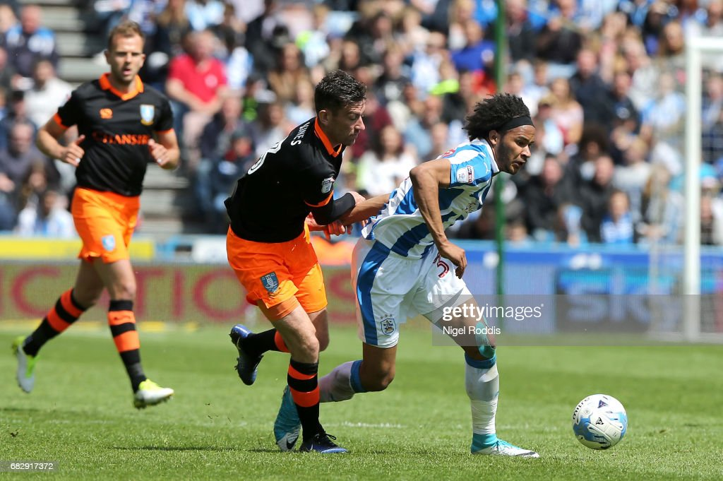 Isaiah Brown of Huddersfield Town is put under pressure from David Jones of Sheffield Wednesday during the Sky Bet Championship Play Off Semi Final 1st leg match between Huddersfield Town and Sheffield Wednesday at Galpharm Stadium on May 14, 2017 in Huddersfield, England.