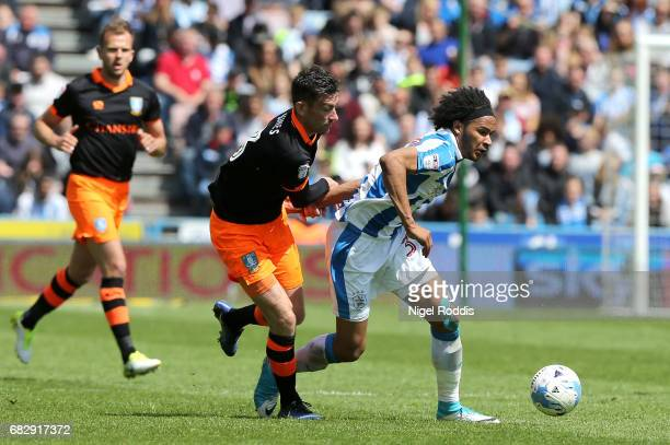Isaiah Brown of Huddersfield Town is put under pressure from David Jones of Sheffield Wednesday during the Sky Bet Championship Play Off Semi Final...