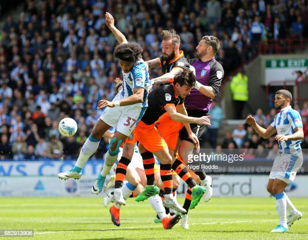 Isaiah Brown of Huddersfield Town Steven Fletcher of Sheffield Wednesday Keiren Westwood of Sheffield Wednesday and Kieran Lee of Sheffield Wednesday...