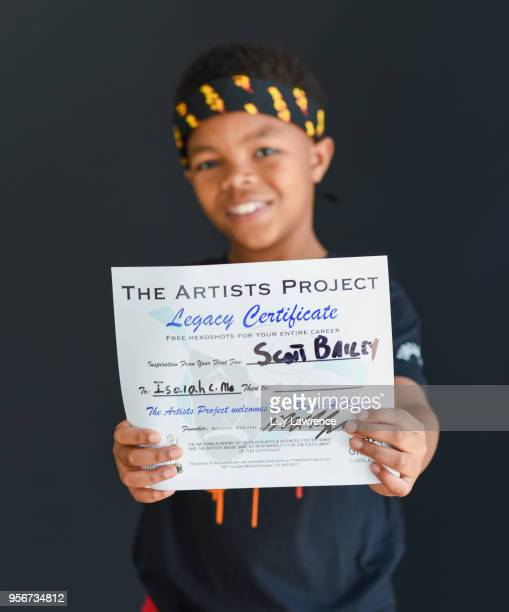 Isaiah C Morgan with Legacy certificate at The Artists Project Giveback Day on May 9 2018 in Los Angeles California