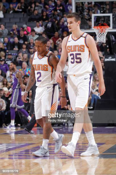 Isaiah Canaan and Dragan Bender of the Phoenix Suns look on during the game against the Sacramento Kings on December 29 2017 at Golden 1 Center in...