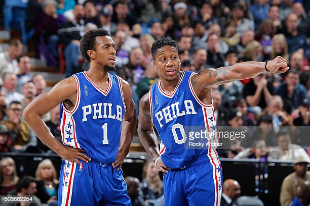 Isaiah Canaan and Ish Smith of the Philadelphia 76ers talk during the game against the Sacramento Kings on December 30 2015 at Sleep Train Arena in...
