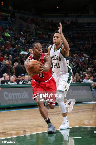 Isaiah Canaan of the Chicago Bulls passes the ball against Rashad Vaughn of the Milwaukee Bucks during the game on March 26 2017 at the BMO Harris...
