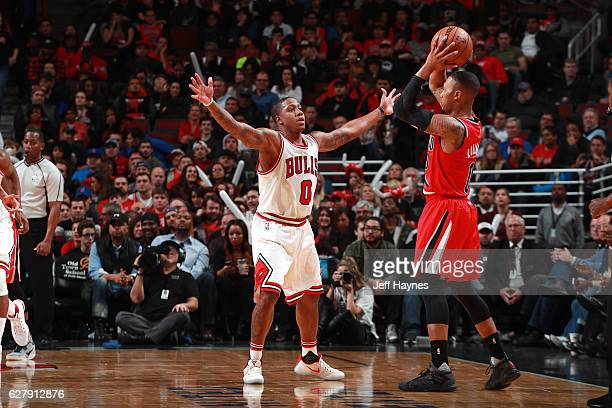 Isaiah Canaan of the Chicago Bulls plays defense against Damian Lillard of the Portland Trail Blazers during the game on December 5 2016 at the...