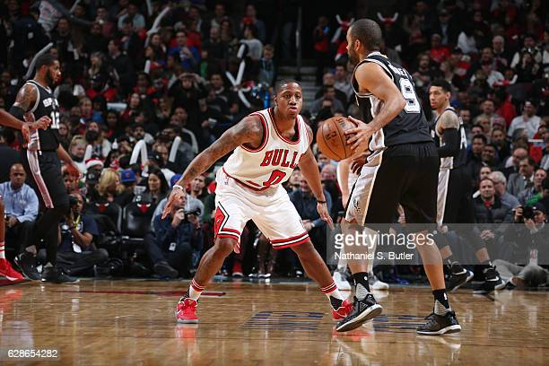 Isaiah Canaan of the Chicago Bulls plays defense against Tony Parker of the San Antonio Spurs during a game at the United Center on December 8 2016...