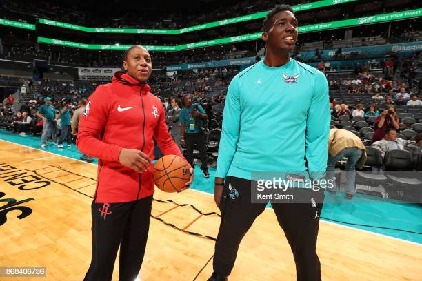Isaiah Canaan of the Houston Rockets and Johnny O'Bryant III of the Charlotte Hornets talk before the game on October 27 2017 at Spectrum Center in...