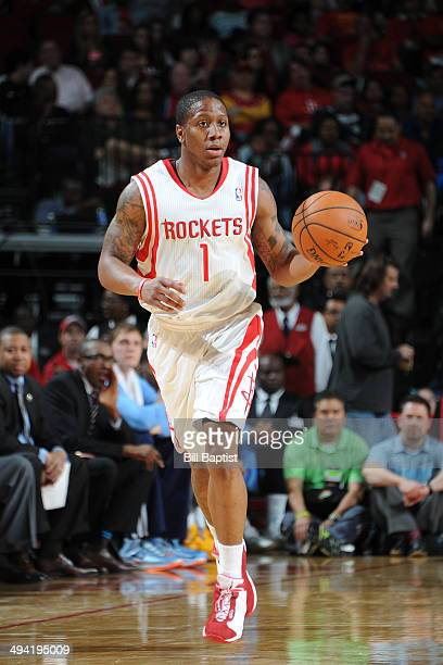 Isaiah Canaan of the Houston Rockets dribbles the ball against the Denver Nuggets on April 6 2014 at the Toyota Center in Houston Texas NOTE TO USER...