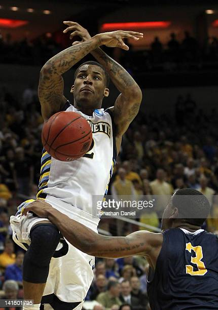 Isaiah Canaan of the Murray State Racers blocks the shot of Vander Blue of the Marquette Golden Eagles in the second half during the third round of...