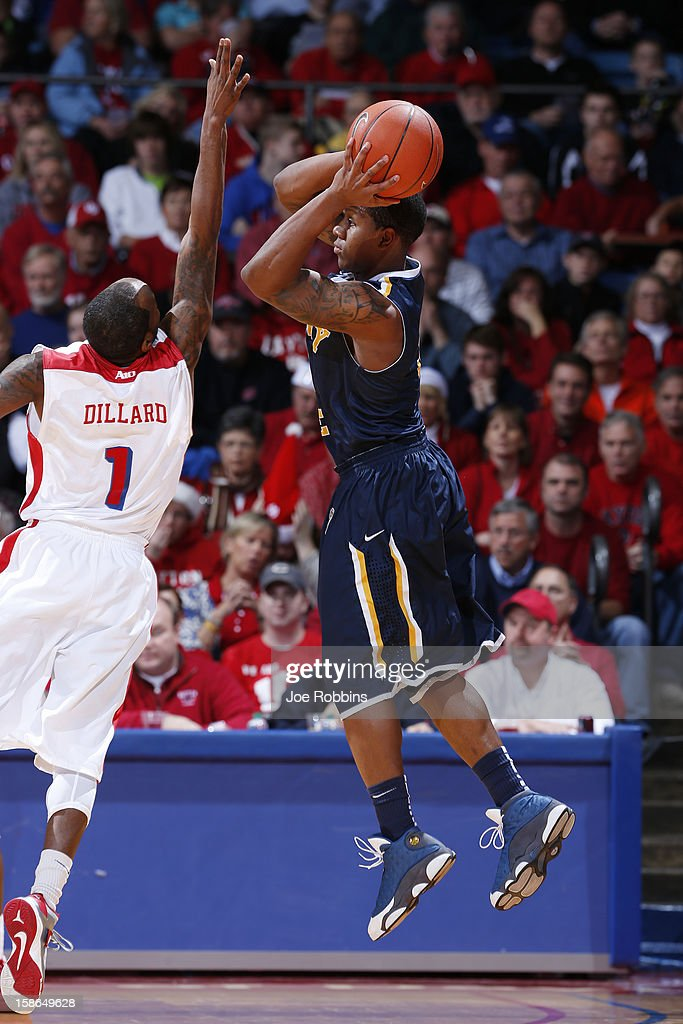 Isaiah Canaan #3 of the Murray State Racers tries to shoot the ball while being defended by Kevin Dillard #1 of the Dayton Flyers during the game at University of Dayton Arena on December 22, 2012 in Dayton, Ohio. The Flyers won 77-68.