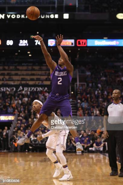 Isaiah Canaan of the Phoenix Suns attempts a shot over Trey Burke of the New York Knicks during the second half of the NBA game at Talking Stick...