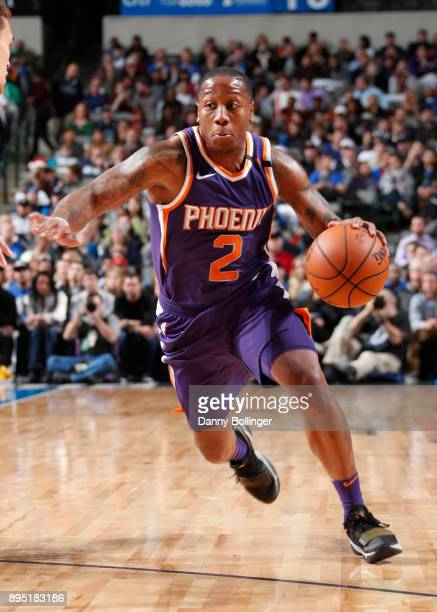 Isaiah Canaan of the Phoenix Suns drives to the basket against the Dallas Mavericks on December 18 2017 at the American Airlines Center in Dallas...