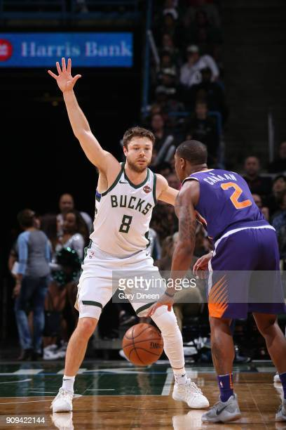 Isaiah Canaan of the Phoenix Suns handles the ball against Matthew Dellavedova of the Milwaukee Bucks during the game between the two teams on...