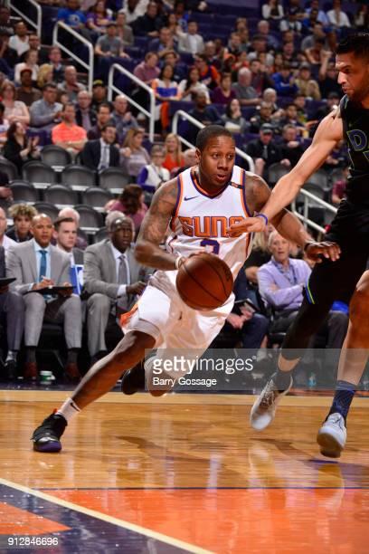 Isaiah Canaan of the Phoenix Suns handles the ball against the Dallas Mavericks on January 31 2018 at Talking Stick Resort Arena in Phoenix Arizona...