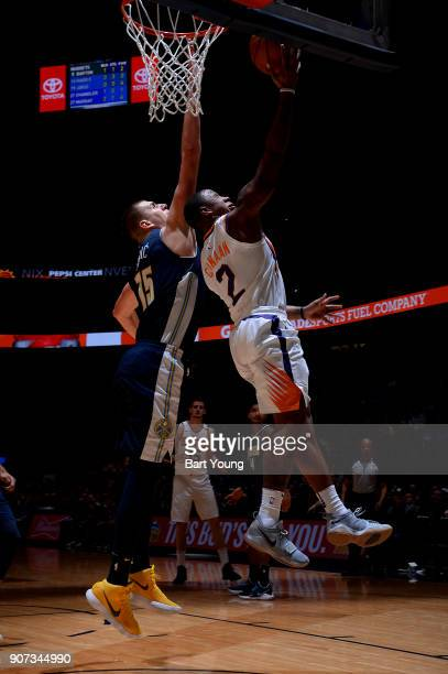 Isaiah Canaan of the Phoenix Suns shoots a lay up against Nikola Jokic of the Denver Nuggetson January 19 2018 at the Pepsi Center in Denver Colorado...