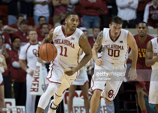Isaiah Cousins of the Oklahoma Sooners handles the ball against Iowa Stare during a NCAA college basketball game at the Lloyd Noble Center on January...