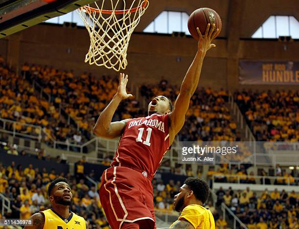 Isaiah Cousins of the Oklahoma Sooners lays one in during the game against the West Virginia Mountaineers at the WVU Coliseum on February 20 2016 in...