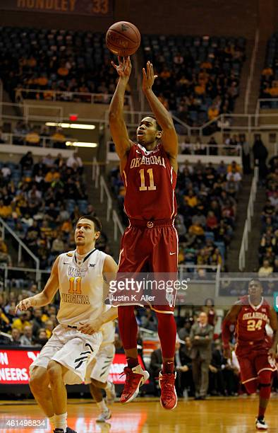 Isaiah Cousins of the Oklahoma Sooners pulls up for a shot in the first half against the West Virginia Mountaineers during the game at the WVU...