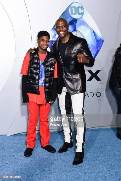 Isaiah Crews and Terry Crews attend the premiere of Warner Bros Pictures' Aquaman at TCL Chinese Theatre on December 12 2018 in Hollywood California