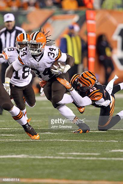 Isaiah Crowell of the Cleveland Browns breaks a tackle by George Iloka of the Cincinnati Bengals during the third quarter at Paul Brown Stadium on...