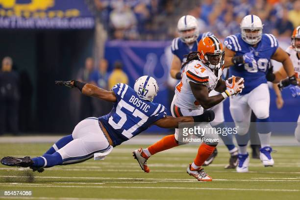 Isaiah Crowell of the Cleveland Browns breaks a tackle from Jon Bostic of the Indianapolis Colts at Lucas Oil Stadium on September 24 2017 in...