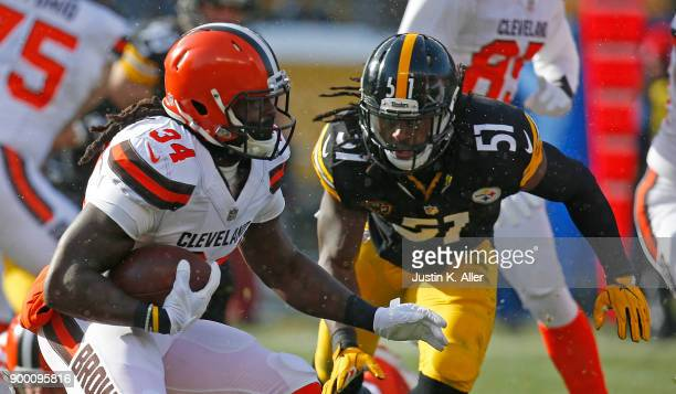 Isaiah Crowell of the Cleveland Browns carries the ball against Sean Spence of the Pittsburgh Steelers in the first quarter during the game at Heinz...