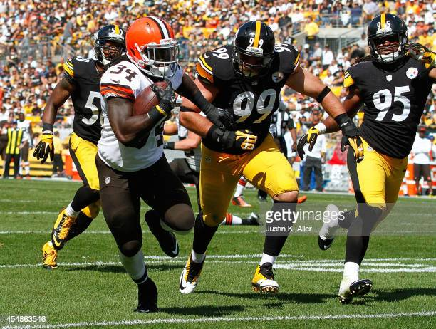 Isaiah Crowell of the Cleveland Browns carries the ball for a touchdown in front of Brett Keisel and Jarvis Jones of the Pittsburgh Steelers during...