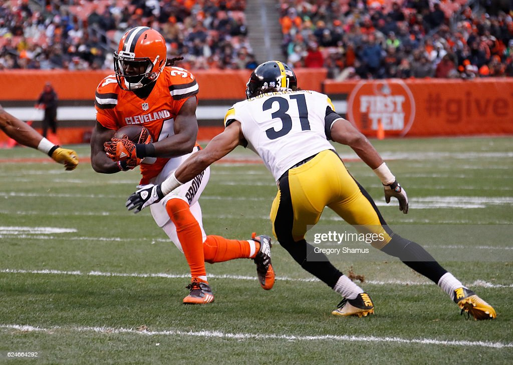 Isaiah Crowell #34 of the Cleveland Browns carries the ball in front of Ross Cockrell #31 of the Pittsburgh Steelers during the fourth quarter at FirstEnergy Stadium on November 20, 2016 in Cleveland, Ohio.