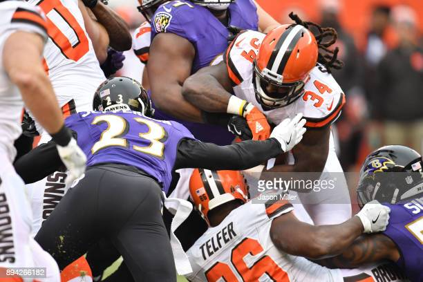 Isaiah Crowell of the Cleveland Browns drives the ball in the first quarter against the Baltimore Ravens at FirstEnergy Stadium on December 17 2017...