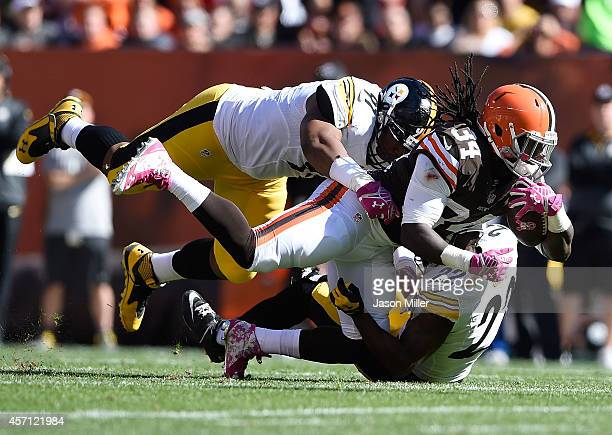 Isaiah Crowell of the Cleveland Browns gets tackled by Cameron Heyward and William Gay of the Pittsburgh Steelers during the second quarter at...