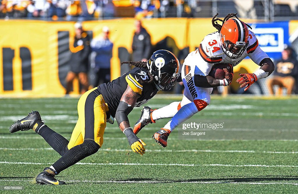 Isaiah Crowell #34 of the Cleveland Browns goes airborne as he rushes against Jarvis Jones #95 of the Pittsburgh Steelers in the first half during the game at Heinz Field on January 1, 2017 in Pittsburgh, Pennsylvania.