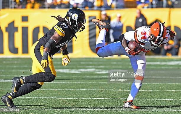 Isaiah Crowell of the Cleveland Browns goes airborne as he rushes against Jarvis Jones of the Pittsburgh Steelers in the first half during the game...