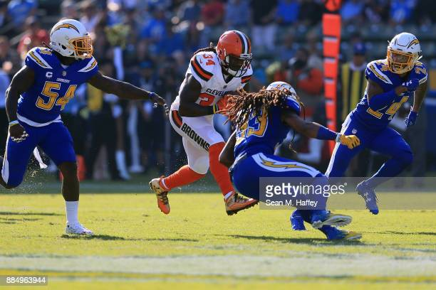 Isaiah Crowell of the Cleveland Browns is hits by Tre Boston of the Los Angeles Chargers during the first half of the game at StubHub Center on...