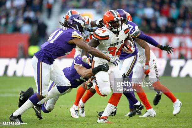 Isaiah Crowell of the Cleveland Browns is tackled by Anthony Harris of the Minnesota Vikings during the NFL International Series match between...