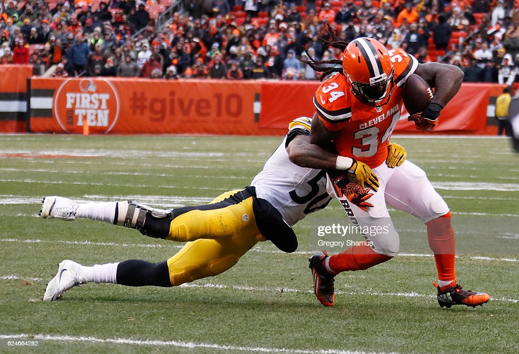 Isaiah Crowell #34 of the Cleveland Browns is wrapped up by Ryan Shazier #50 of the Pittsburgh Steelers during the fourth quarter at FirstEnergy Stadium on November 20, 2016 in Cleveland, Ohio.