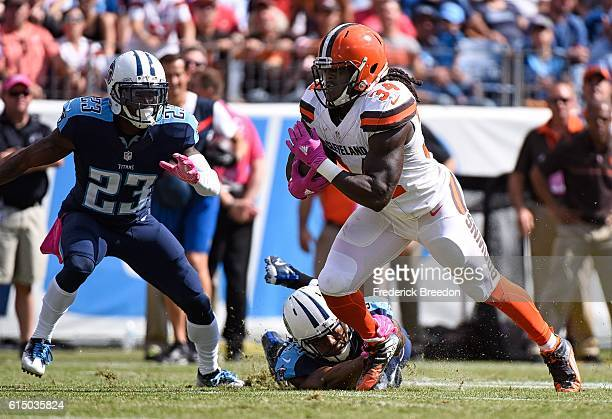 Isaiah Crowell of the Cleveland Browns rushes against Brice McCain of the Tennessee Titans during the first half at Nissan Stadium on October 16 2016...