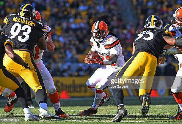 Isaiah Crowell of the Cleveland Browns rushes against the Pittsburgh Steelers in the first half during the game at Heinz Field on January 1 2017 in...