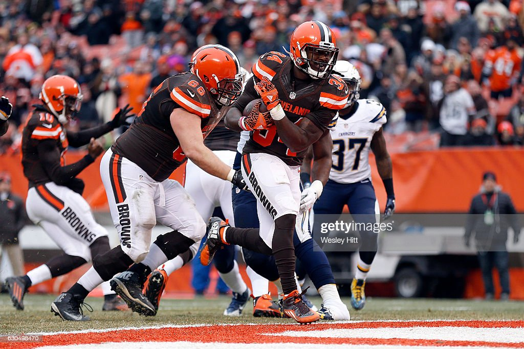 Isaiah Crowell #34 of the Cleveland Browns rushes for a 4 yard touchdown in the second quarter against the San Diego Chargers at FirstEnergy Stadium on December 24, 2016 in Cleveland, Ohio.