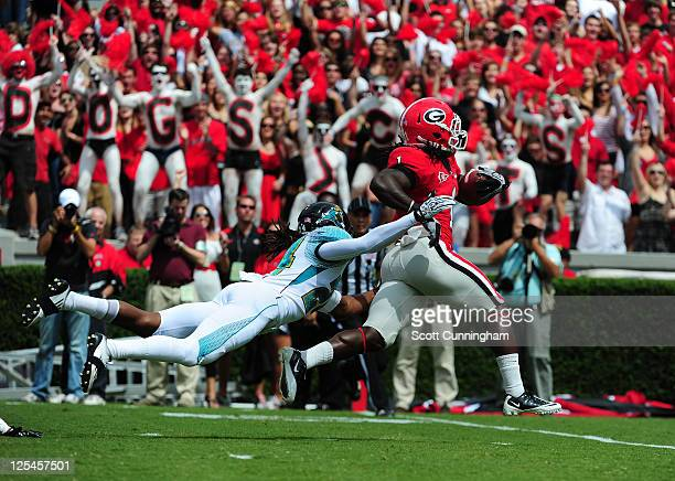 Isaiah Crowell of the Georgia Bulldogs runs for a touchdown against Josh Norman of the Coastal Carolina Chanticleers at Sanford Stadium on September...