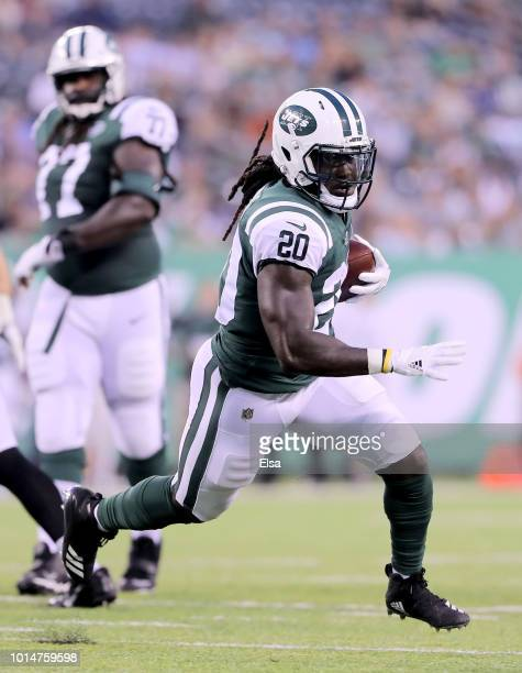 Isaiah Crowell of the New York Jets runs the ball in for a touchdown in the first quarter against the Atlanta Falcons during a preseason game at...