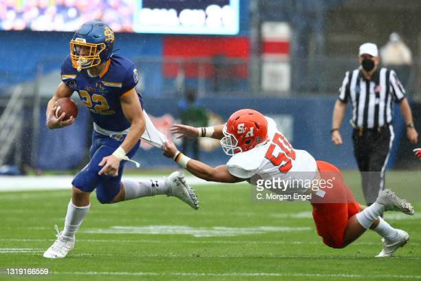 Isaiah Davis of the South Dakota State Jackrabbits breaks a tackle by Ysidro Mascorro of the Sam Houston State Bearkats during the Division I FCS...