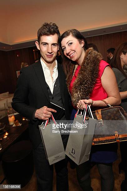 Isaiah Freeman and Monica Dimperio at the Chicago launch of Dewar's Browne Bag hosted by Dewar's and Thom Browne at Public Hotel on December 6 2011...