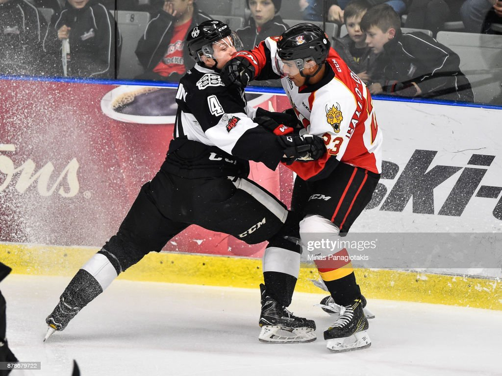Isaiah Gallo-Demetris #23 of the Baie-Comeau Drakkar (R) challenges Aleksi Anttalainen #4 of the Blainville-Boisbriand Armada during the QMJHL game at Centre d'Excellence Sports Rousseau on November 24, 2017 in Boisbriand, Quebec, Canada.