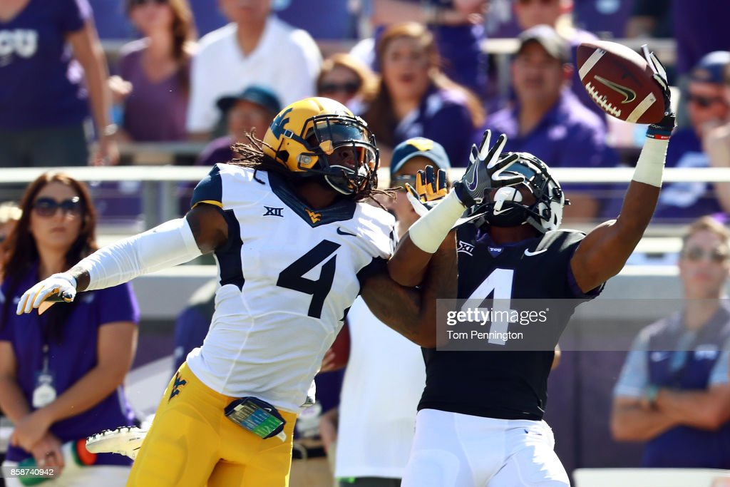 Isaiah Graham #4 of the TCU Horned Frogs goes up for a pass against Mike Daniels Jr. #4 of the West Virginia Mountaineers in the first half at Amon G. Carter Stadium on October 7, 2017 in Fort Worth, Texas.