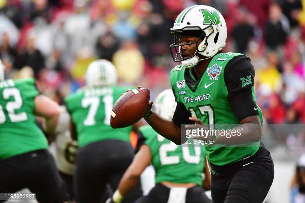 Isaiah Green of the Marshall Thundering Herd looks to pass during the second quarter against the UCF Knights at the Bad Boy Mowers Gasparilla Bowl at...