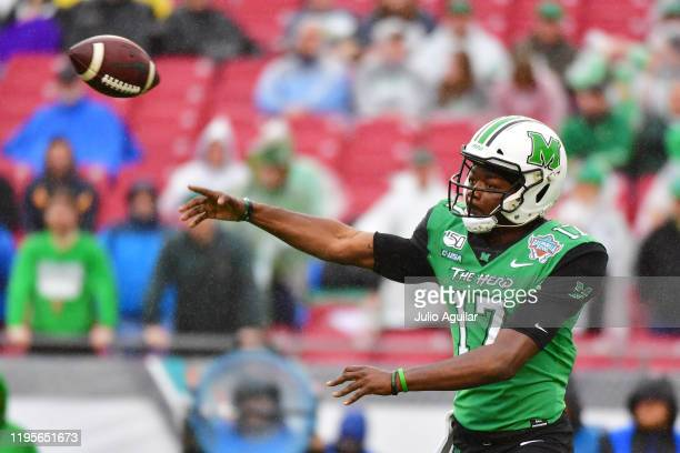 Isaiah Green of the Marshall Thundering Herd throws a pass during the first quarter against the UCF Knights at the Bad Boy Mowers Gasparilla Bowl at...